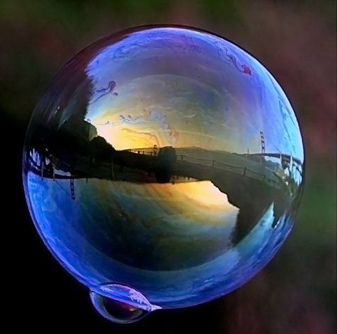 Golden Gate Bridge is reflected in a soap bubble by Brocken Inaglory. Used under CC BY-SA 3.0. No changes made.
